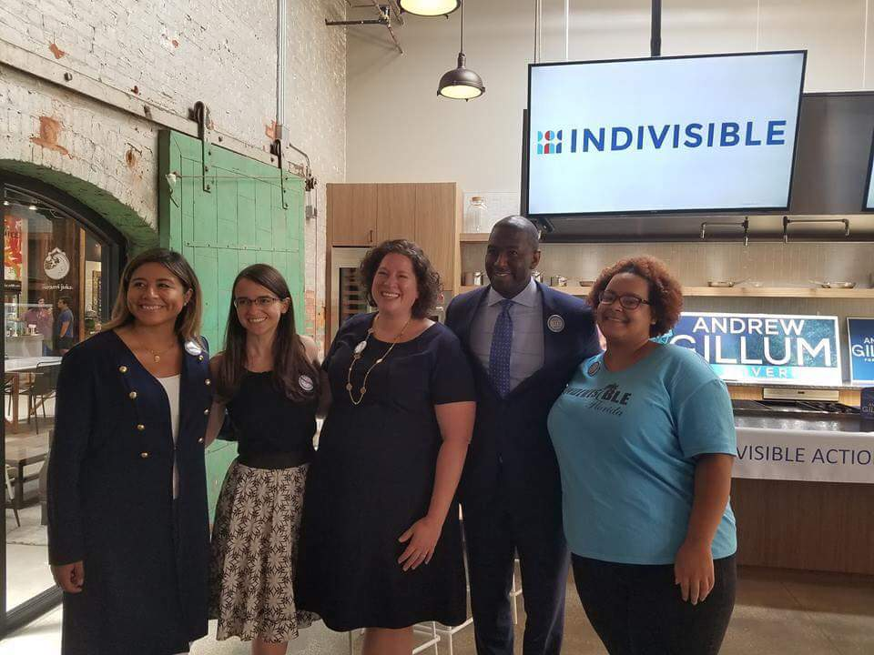 Indivisible staff and group leaders standing with Andrew Gillum