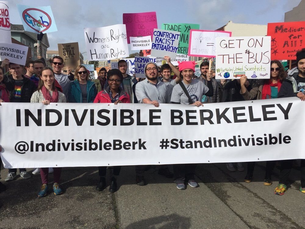 "Image of Indivisible Berkeley group members holding a banner that reads ""Indivisible Berkeley"""