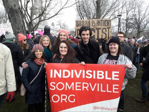"Image of Indivisible Somerville group members at a rally with a banner that reads ""Indivisible Somerville"""