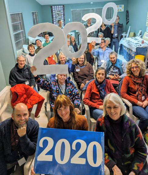 "Image of Indivisible group members holding ""2020"" signs"